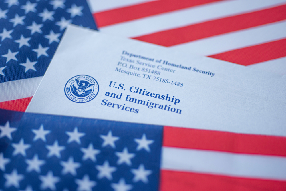 letter from USCIS on top the U.S. flag